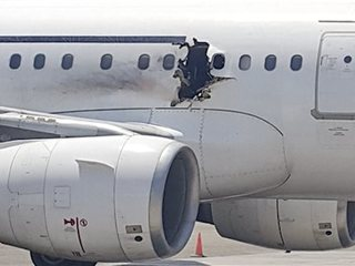 Somali official: Bomb blew hole in passenger jet