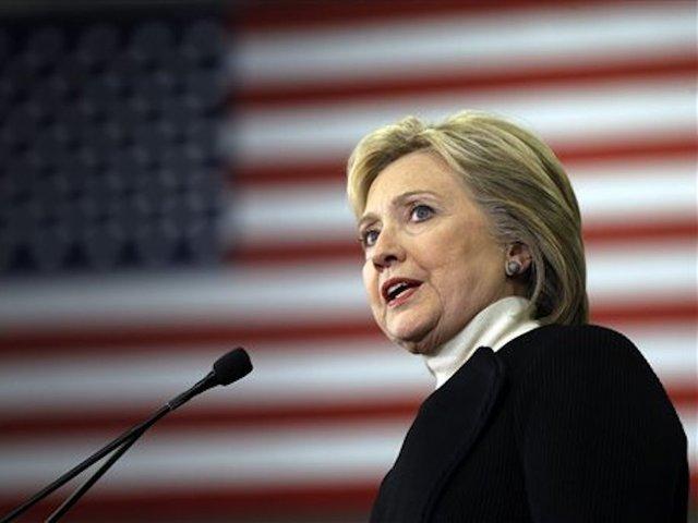 Clinton, Sanders to Debate After Splitting Contests