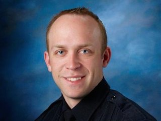Fargo police: Officer shot in standoff dies