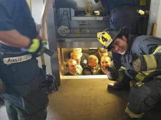 Police officers stuck in elevator call for help