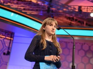 Teen enjoying Spelling Bee spotlight