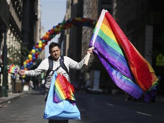 Parades balance pride, sorrow for Orlando