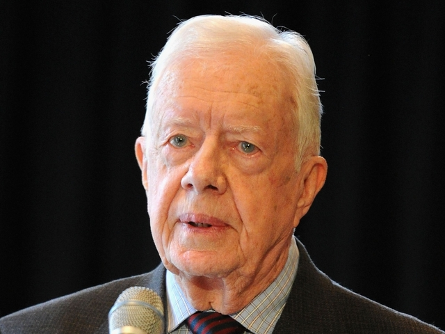 Jimmy Carter returns to work site after leaving hospital