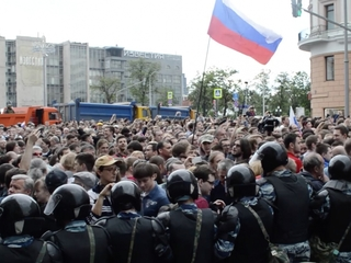 Russians protest across country, leader arrested
