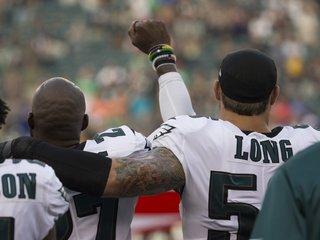 Philadelphia Eagle hugs teammate during protest