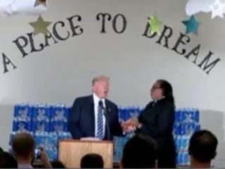 Trump can only nod as Flint pastor stops speech
