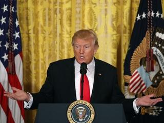 Trump admits travel ban defeat, plans new order