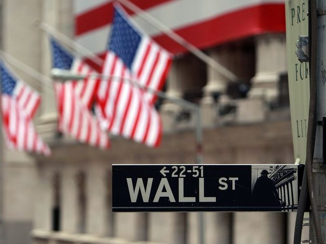 Wall St dips but trading volatile; bond prices rise