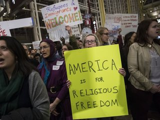 NY lawsuit over Trump travel ban settled