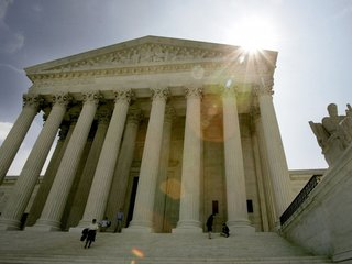 Supreme Court lifts restrictions on travel ban