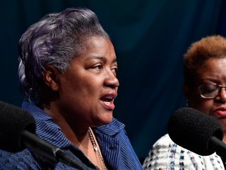 Ex-DNC head slams 'secret takeover' by Clinton
