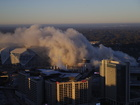 Bus photobombs stadium implosion