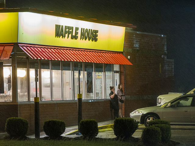 biloxims october 7 2017 waffle house employees take a smoke break at their restaurant which sits 75 feet from the beach as the eye of hurricane nate - What Restaurants Will Be Open On Christmas Day