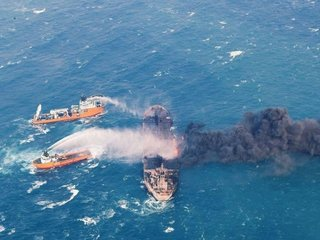 Oil tanker burning off China's coast sinks