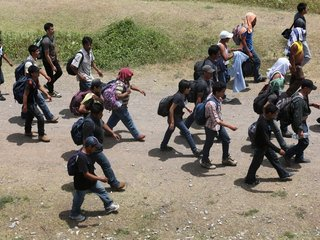 Who are the migrants crossing the border?