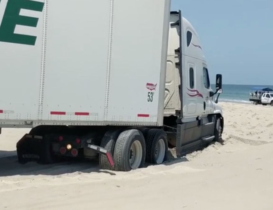 whoops  semi truck gets stuck on the beach in north