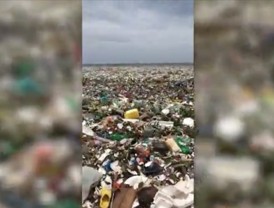 beach in dominican republic covered in garbage  plastic