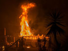 9 dead as fires spread on both ends of Cali.